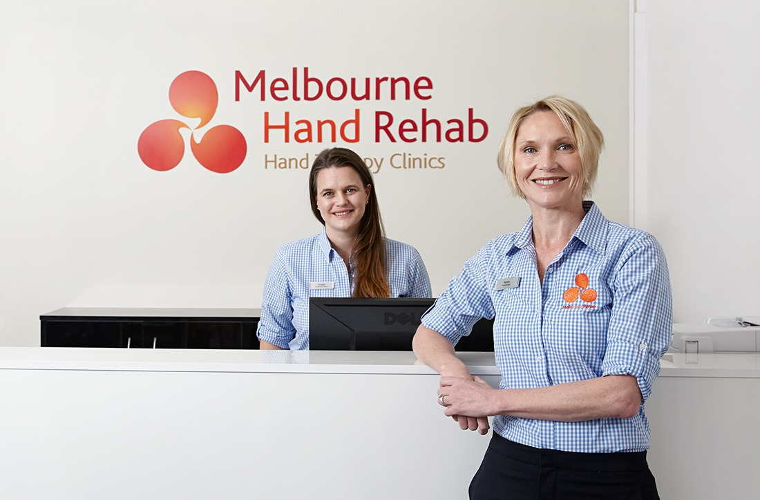 A picture of Karen Fitt and Melbourne Hand Rehab reception.