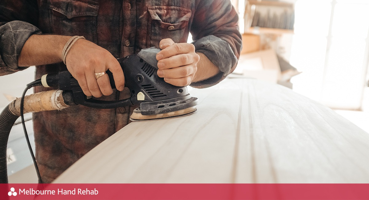Carpenter sanding wood