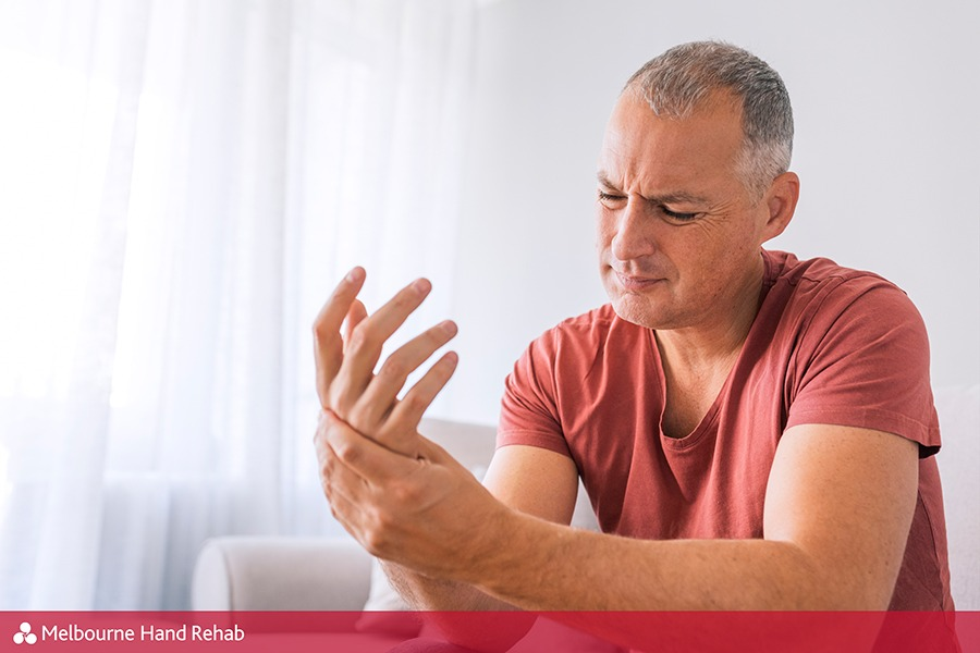 Man with painful hand before visiting a hand therapist