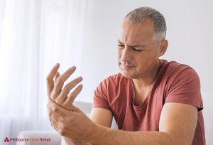 Mature man suffering from wrist pain