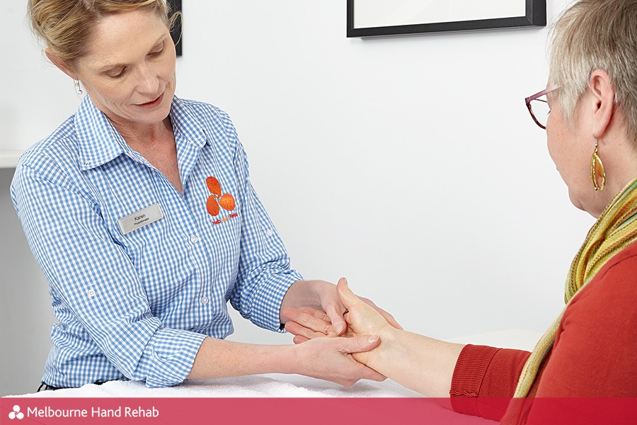 Melbourne Hand Rehab hand therapist Karen Fitt attends to a patient