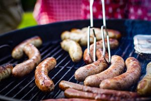 Sausages in BBQ during backyard cricket match