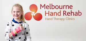 young girl giving a thumbs up after have a custom splint made for her at Melbourne Hand Rehab