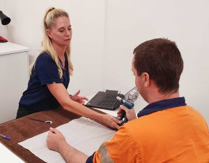 Melbourne Hand Rehab therapist with a 'return to work' patient