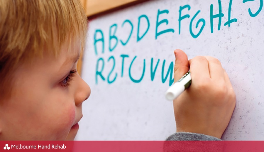 Child writing on whiteboard