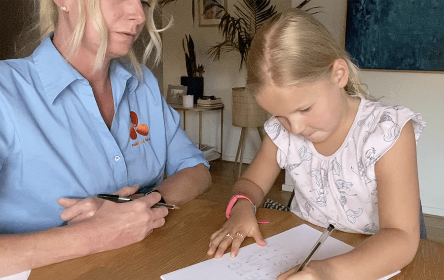 Assessment of child's handwriting by Melbourne Hand Rehab hand therapist