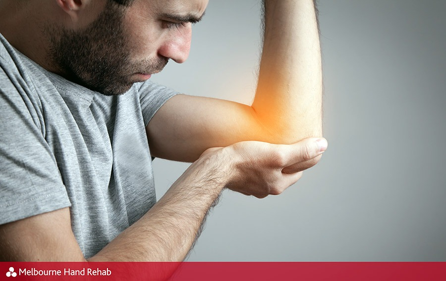 Man with possible tennis elbow injury