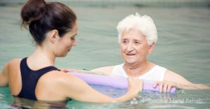 Instructor And Elderly Patient Undergoing Hydrotherapy