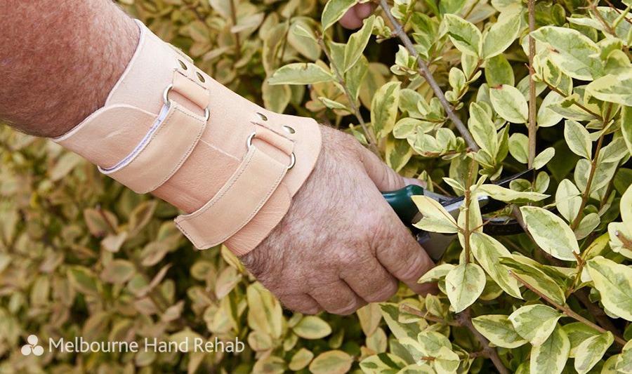 Gardener wearing a Melbourne Hand Rehab custom made leather splint