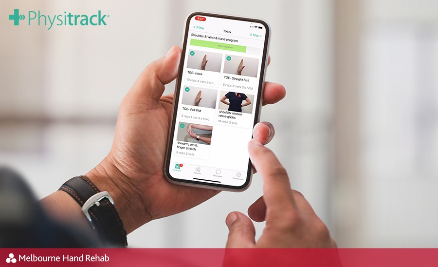 Person holding a mobile phone while using the Physitrack program via the PhysiApp