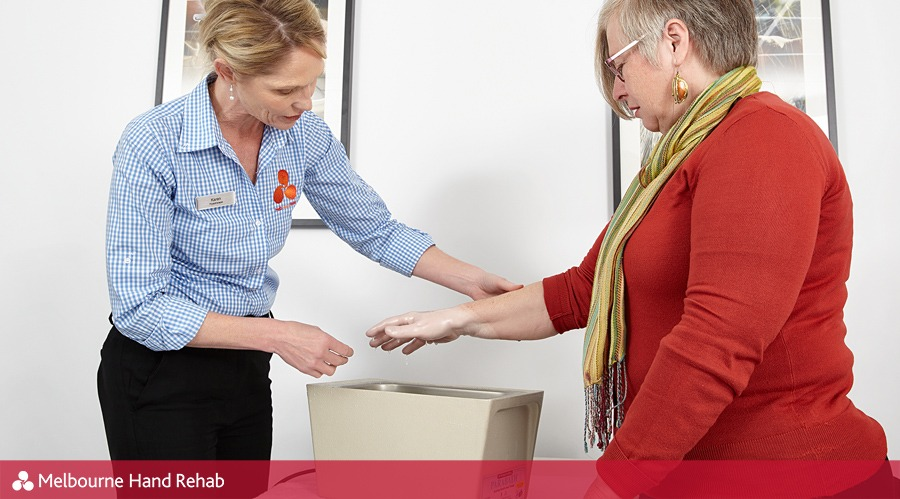 Melbourne Hand Rehab therapist using paraffin wax therapy on a patient